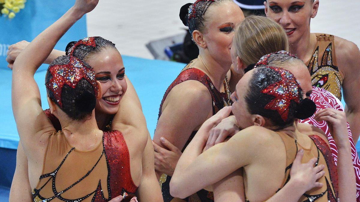 Russia's team celebrate winning the gold medal in the synchronised swimming teams free routine final during the London 2012 Olympic Games at the Aquatics Centre