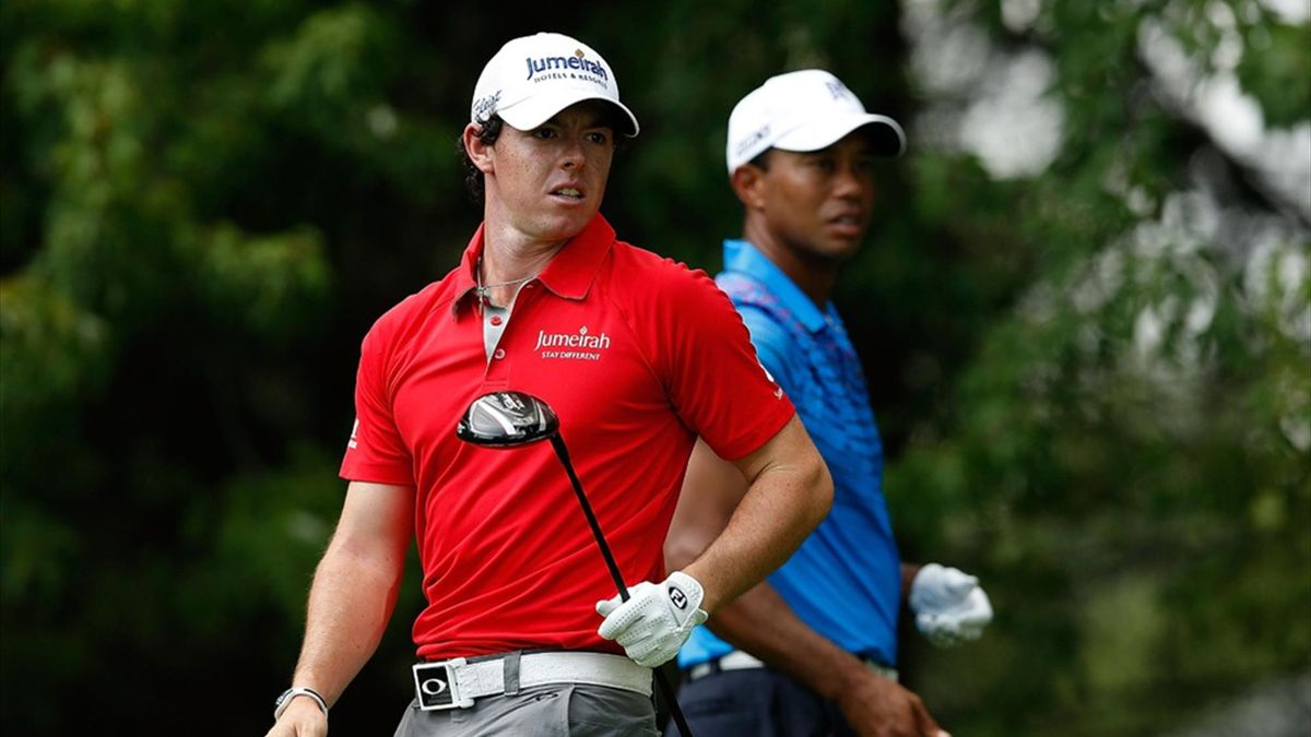 Rory McIlroy and Tiger Woods during the first round of the BMW Championship at Crooked Stick Golf Club (AFP)