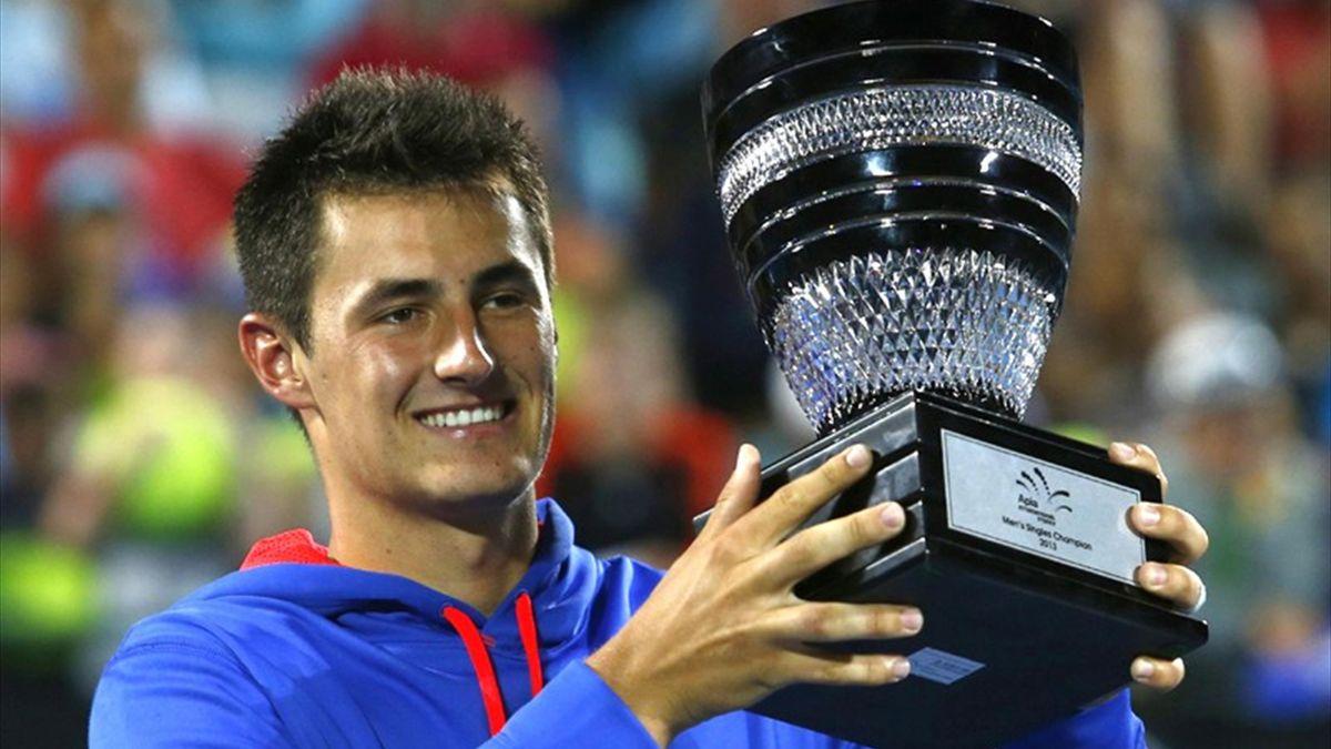 Bernard Tomic celebrates the ATP Sydney title (Reuters)