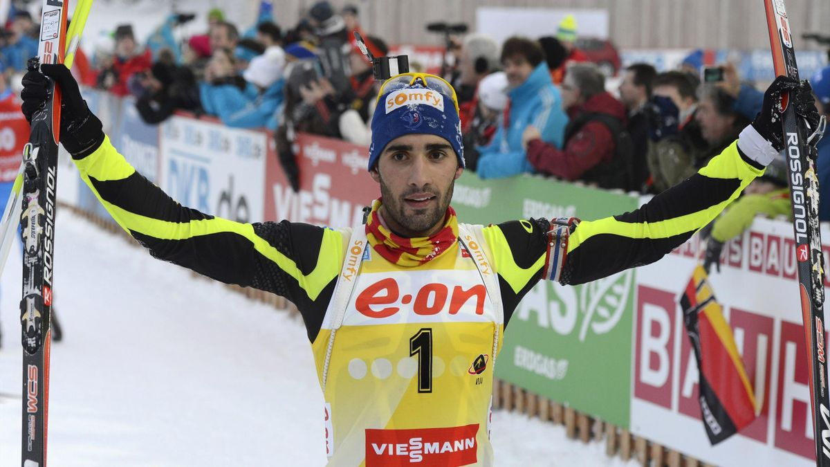 French Martin Fourcade celebrates after the 15 km men Biathlon World Cup mass start competition on January 13, 2013, in Ruhpolding