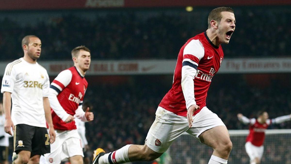 Jack Wilshere celebrates his winning goal against Swansea (Reuters)