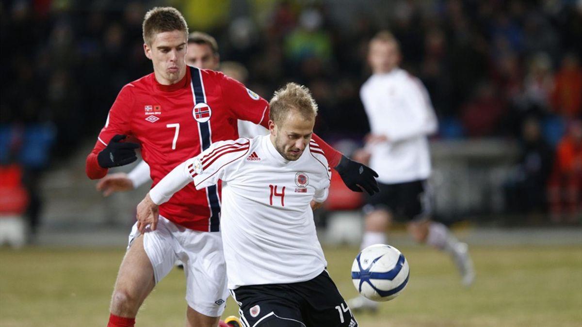 Norway's Markus Henriksen (L) in duel with Migjen Basha of Albania (AFP)