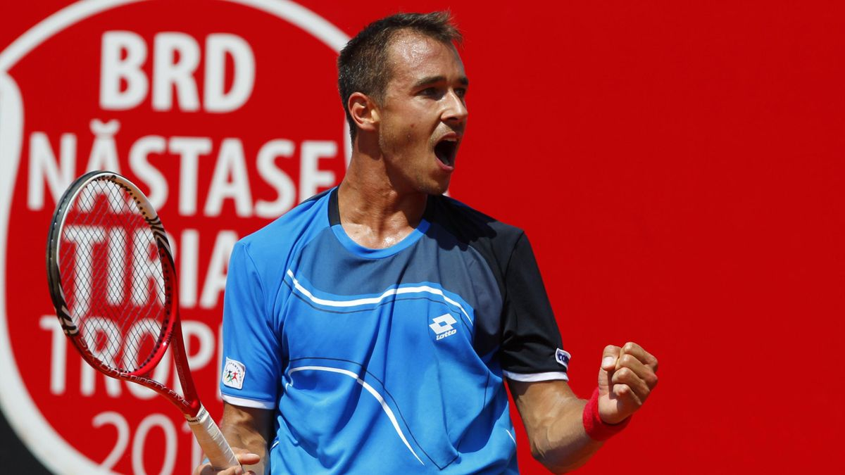 Lukas Rosol of Czech Republic celebrates after defeating Gilles Simon of France in their men's singles semifinal match at the Bucharest International tennis tournament in Bucharest April 27, 2013. REUTERS