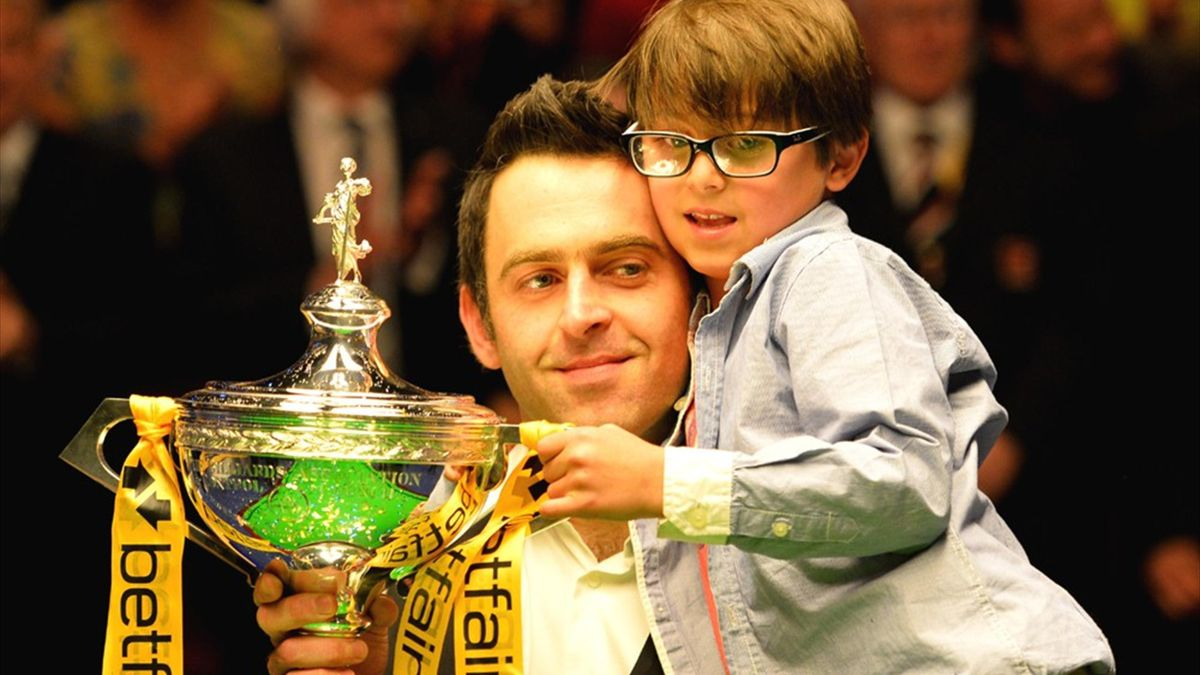 Ronnie O'Sullivan celebrates winning his fifth World Championship crown with his son at the Crucible (AFP)