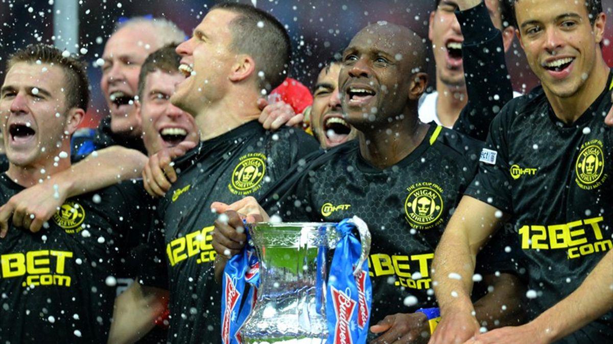 Les joueurs de Wigan savourent leur victoire face à Manchester City.