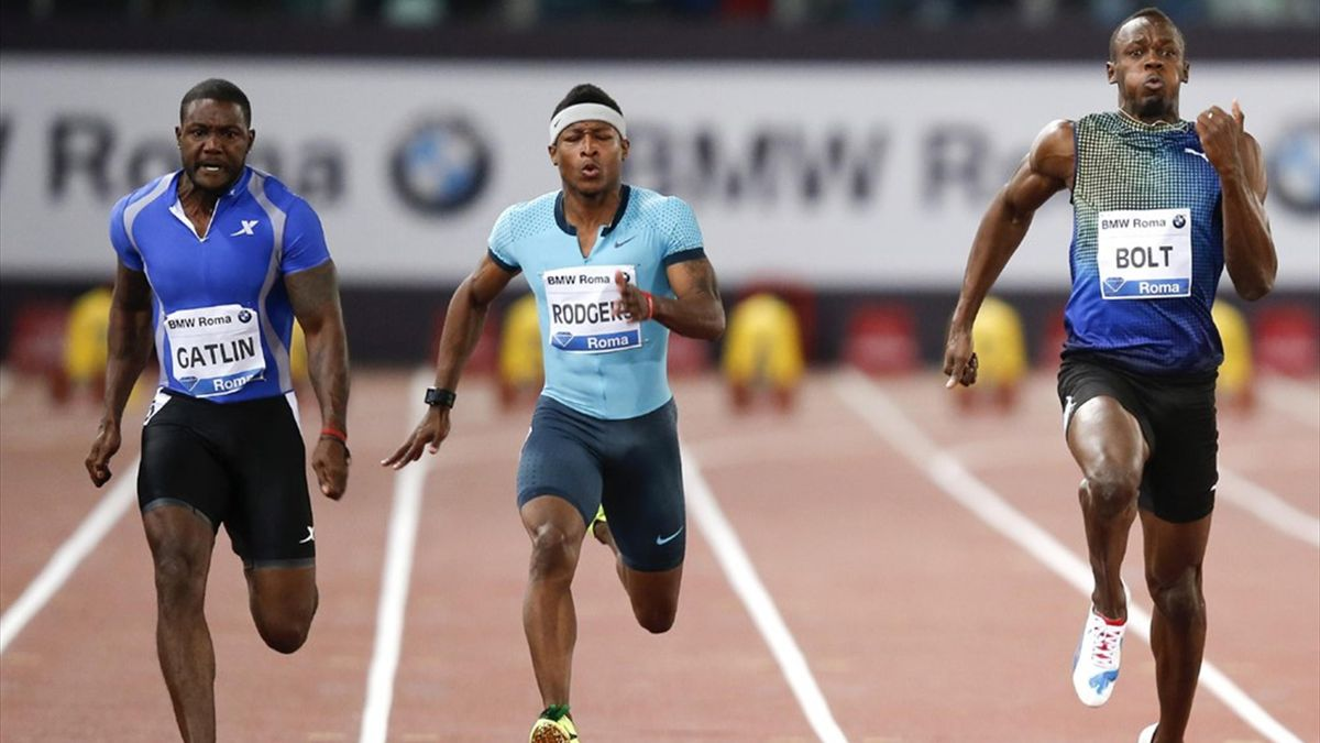Usain Bolt of Jamaica (R) competes with Justin Gatlin of the U.S. (L) during the men's 100m event at the Golden Gala IAAF Diamond League at the Olympic stadium in Rome  (Reuters)