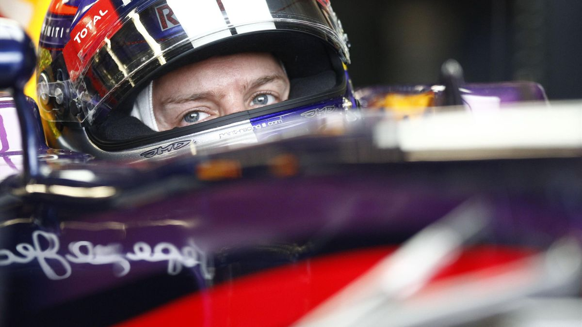 Red Bull Formula One driver Sebastian Vettel of Germany looks on from his car during the first practice session of the Canadian F1 Grand Prix at the Circuit Gilles Villeneuve in Montreal June 7, 2013 (Reuters)