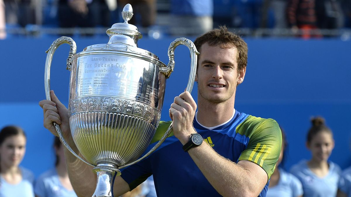 Andy Murray poses with the Queen's trophy after winning the 2013 final (AFP)