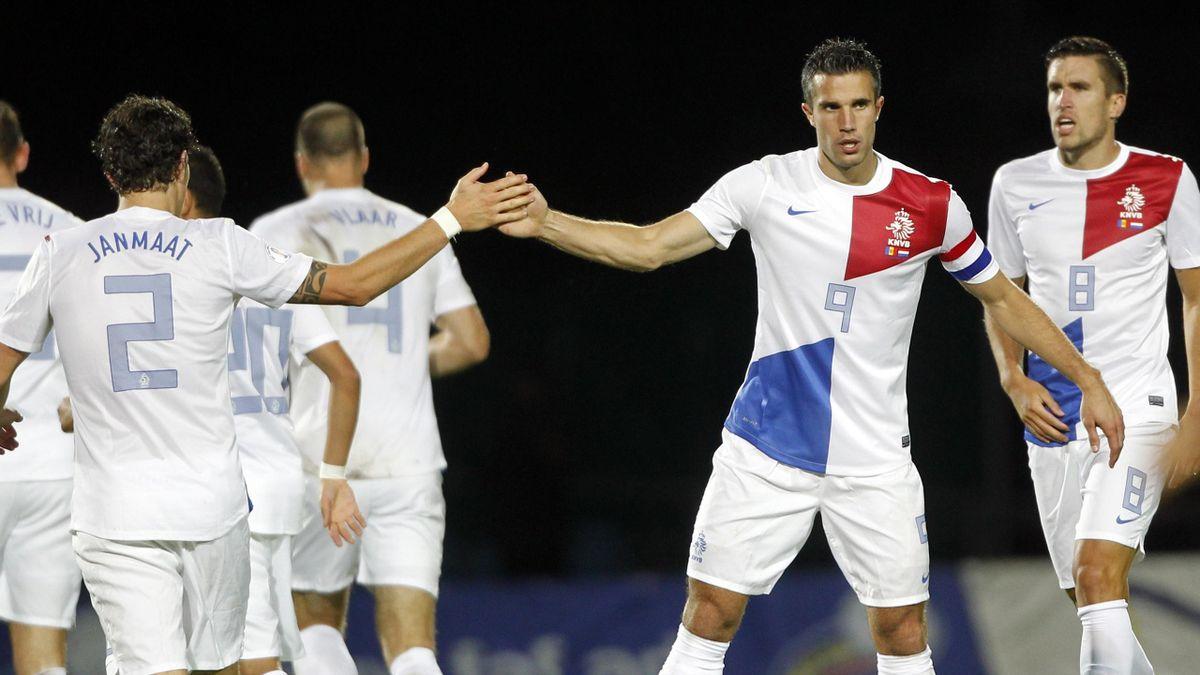 Netherlands' Robin Van Persie (9) celebrates with teammate Darryl Janmaat after scoring a goal against Andorra (Reuters)