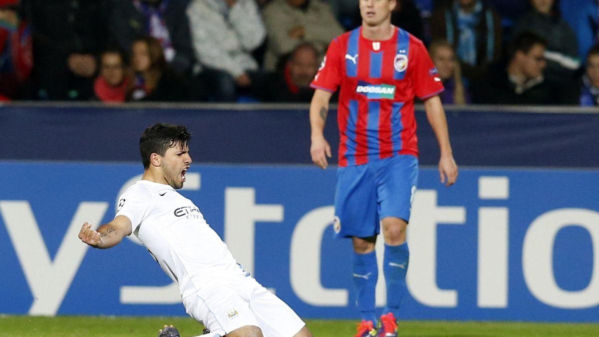 Manchester City's Sergio Aguero (L) celebrates after scoring a goal as Viktoria Plzen's Daniel Kolar reacts during their Champions League group D match (Reuters)