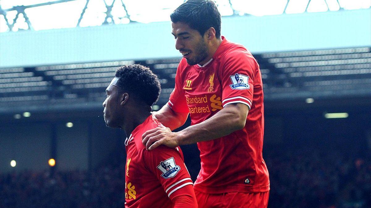 Liverpool's Daniel Sturridge (L) celebrates scoring a goal with teammate Uruguayan striker Luis Suarez