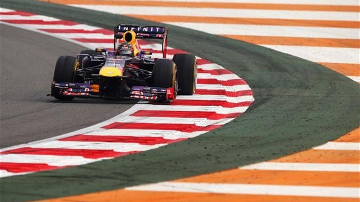 Sebastian Vettel of Germany and Infiniti Red Bull Racing exits the pitlane