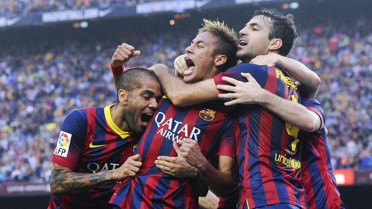 Dani Alves and Cesc Fabregas congratulate Neymar on his goal for Barcelona against Real Madrid (Getty)