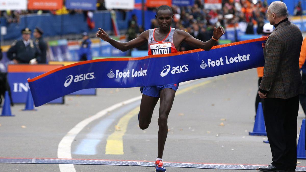 Geoffrey Mutai of Kenya crosses the finish line at the New York marathon (Reuters)