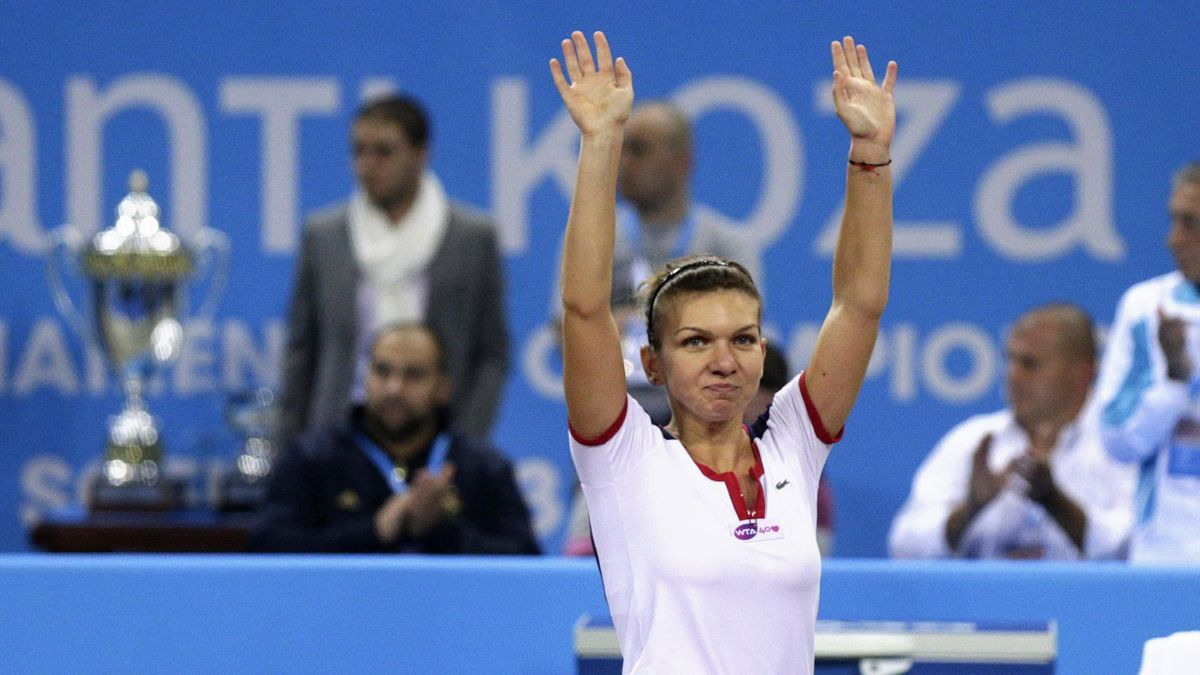 Simona Halep of Romania celebrates defeating Samantha Stosur of Australia during the WTA Tournament of Champions final in Sofia (Reuters)