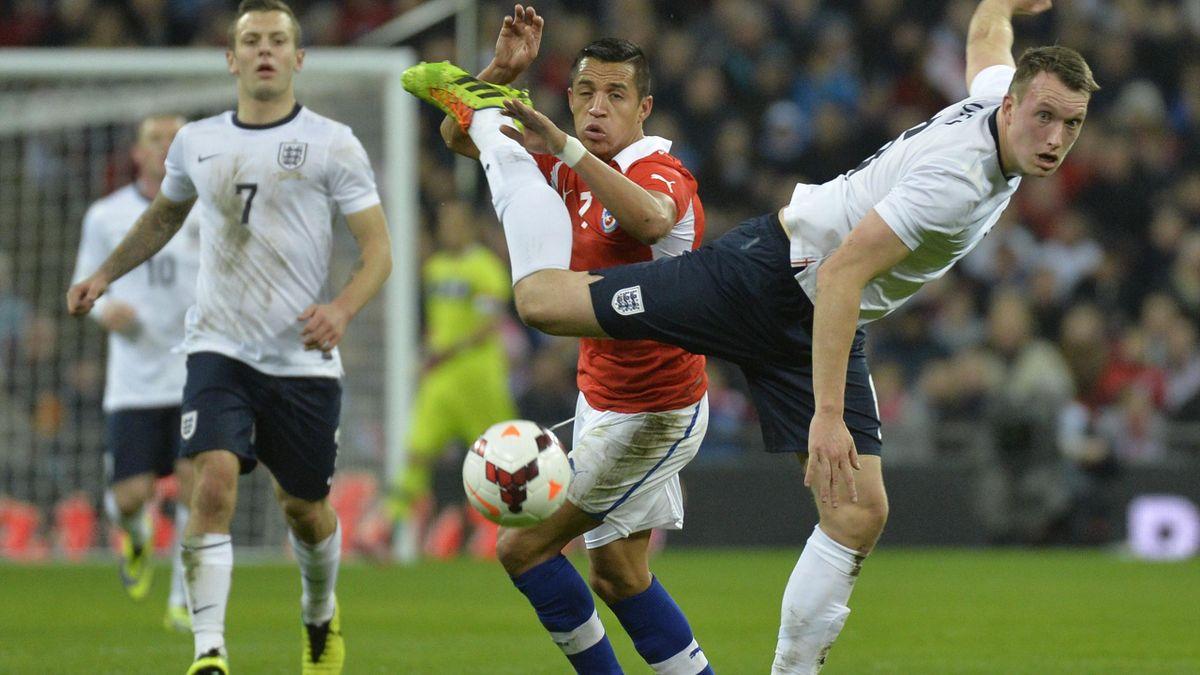 England's Phil Jones collides with Alexis Sanchez of Chile (Reuters)