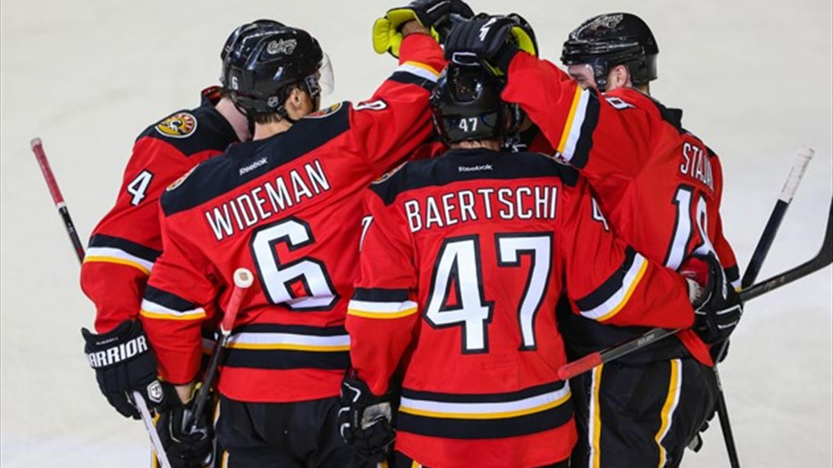 Calgary Flames defenseman Dennis Wideman (6) celebrates a goal with team-mates against the Edmonton Oilers (Reuters)