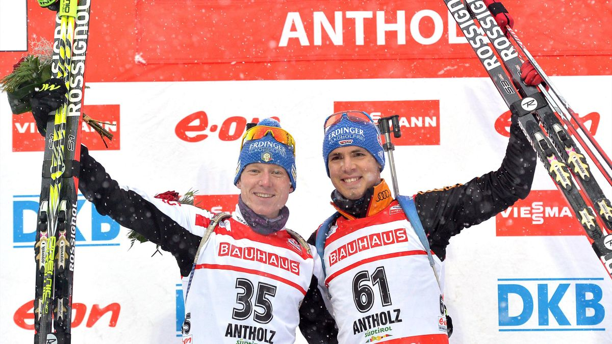 Italy's Lukas Hofer (L) and Germany's Simon Schempp celebrate on the podium after winning ex-aequo the men's 10 km sprint at the IBU Biathlon World Cup (AFP)