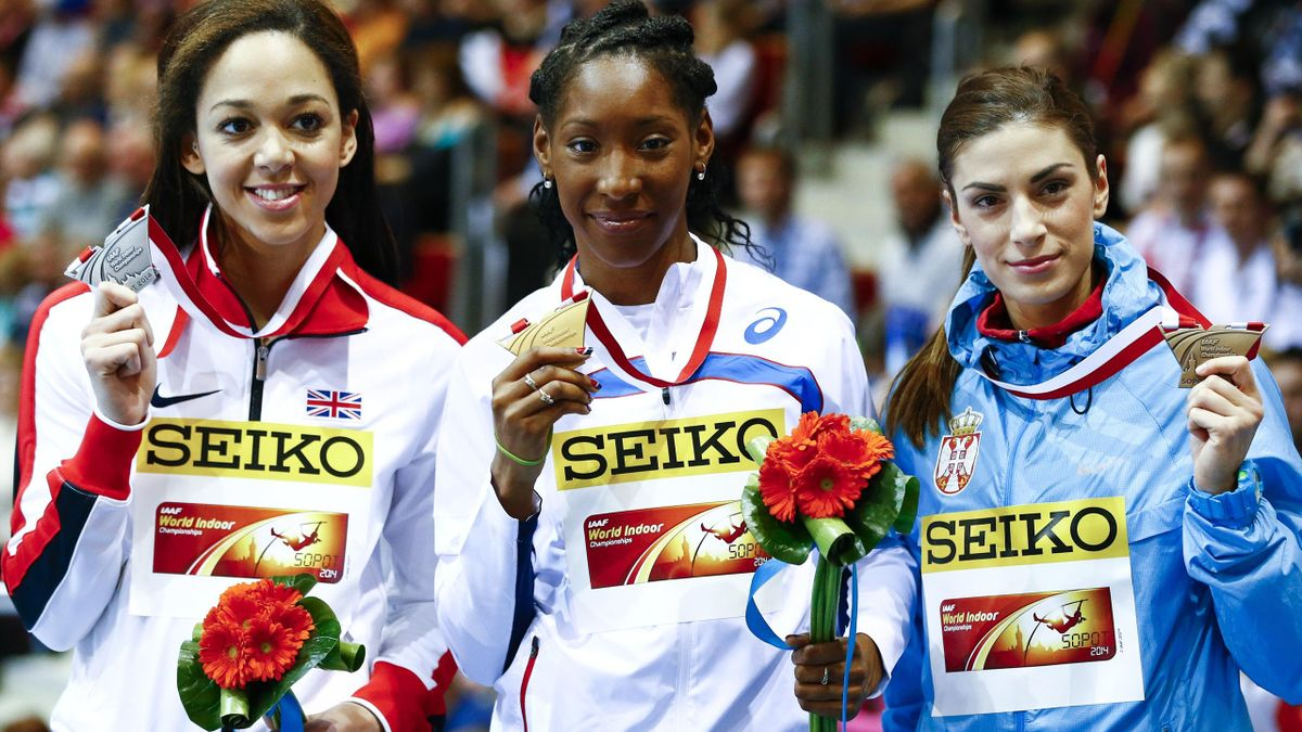 Second placed Katarina Johnson-Thompson of Britain, first placed Eloyse Lesueur of France and third placed Ivana Spanovic of Serbia (L-R) pose with their medals during medals ceremony for the women's long jump at the world indoor athletics championships