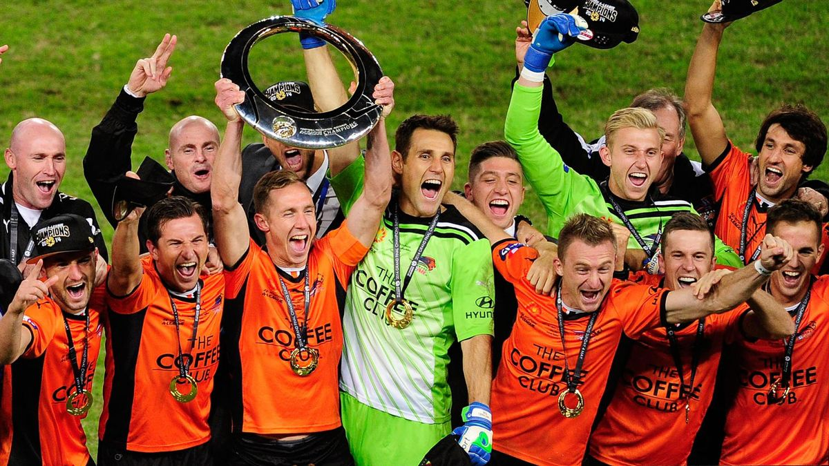 The Brisbane Roar celebrate after winning the 2014 A-League Grand Final match between the Brisbane Roar and the Western Sydney Wanderers at Suncorp Stadium (Getty)
