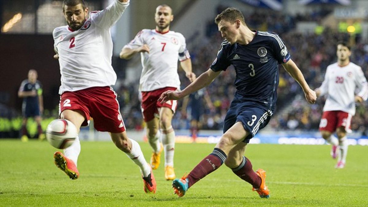 Andrew Robertson, right, has enjoyed an impressive start to his Scotland career