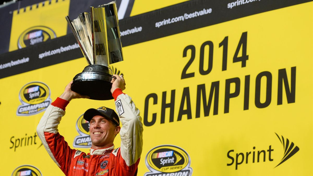 Kevin Harvick, driver of the #4 Budweiser Chevrolet, celebrates with the trophy in victory lane after winning the NASCAR Sprint Cup Series Ford EcoBoost 400 at Homestead-Miami Speedway on November 16, 2014 (Getty)