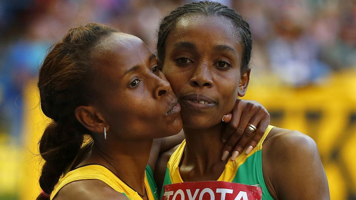 Meseret Defar of Ethiopia (C) celebrates winning the World Championship 5,000 metres with team-mate Almaz Ayana (R).