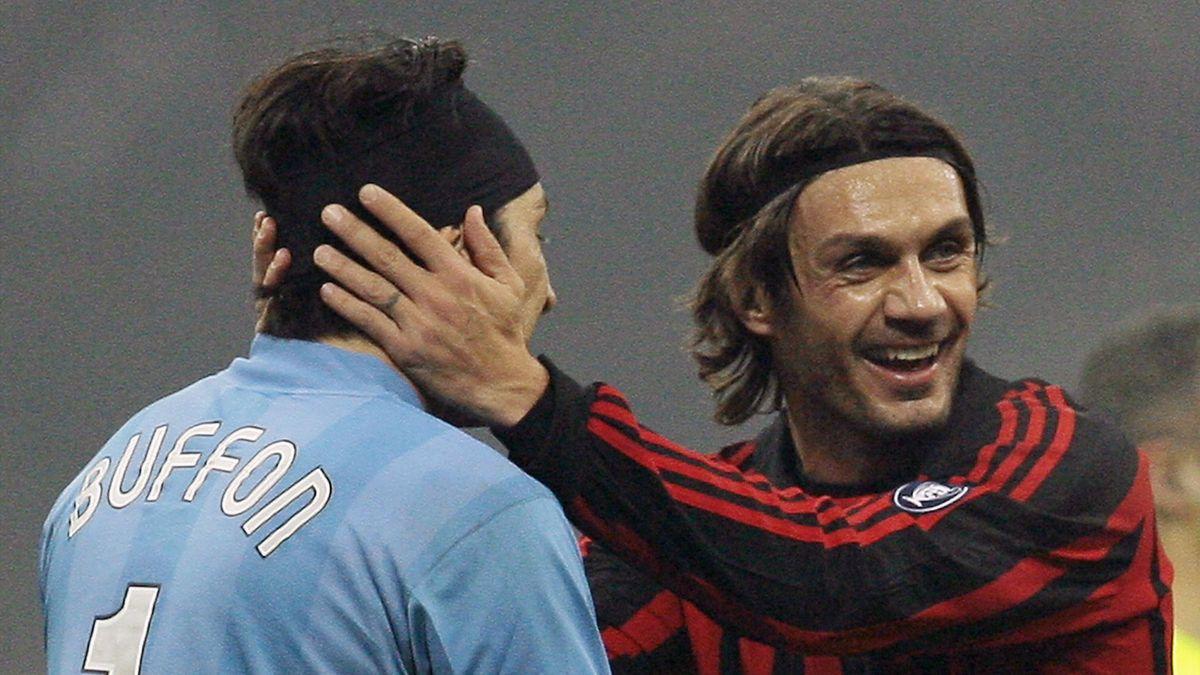 AC Milan's Paolo Maldini (R) embraces Juventus goalkeeper Gianluigi Buffon