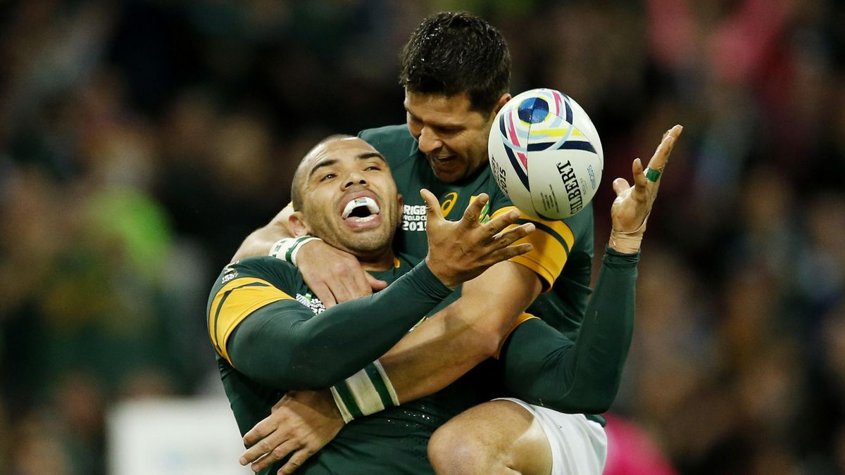 South Africa's Bryan Habana celebrates scoring a try with Morne Steyn