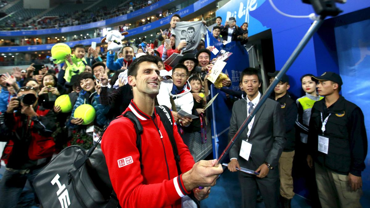Novak Djokovic enjoys a selfie Beijing.