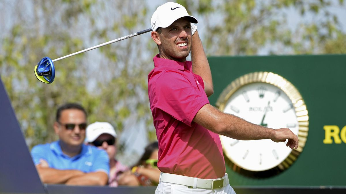 Charl Schwartzel of South Africa looks at the ball after the tee off at the second hole during DP World Tour Championship in Dubai November 21, 2015.
