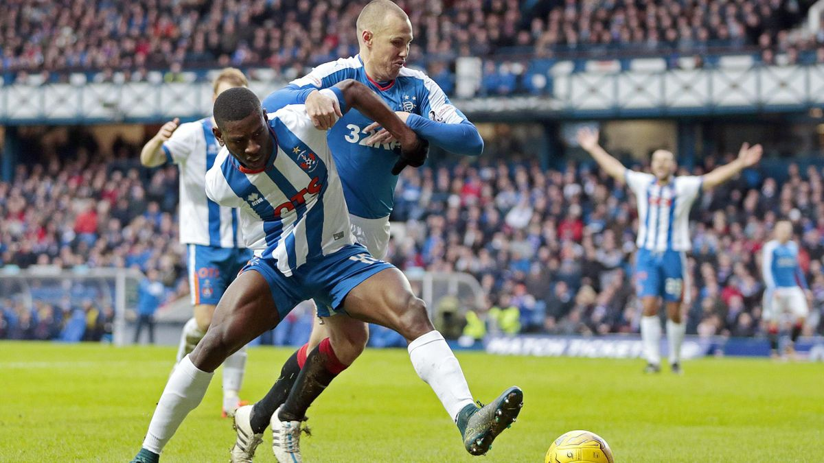Rangers' Kenny Miller (R) in action with Kilmarnock's Temitope Obadeyi.