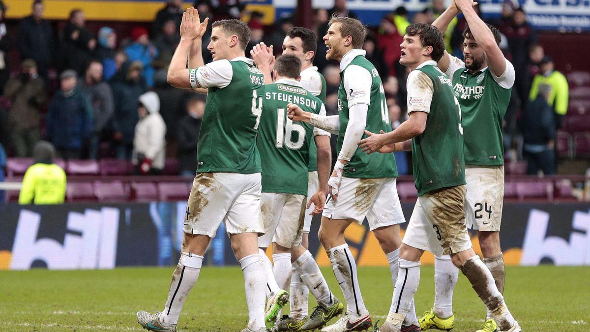 Hibernian's Paul Hanlon (L) celebrates with team mates at the end of the match.