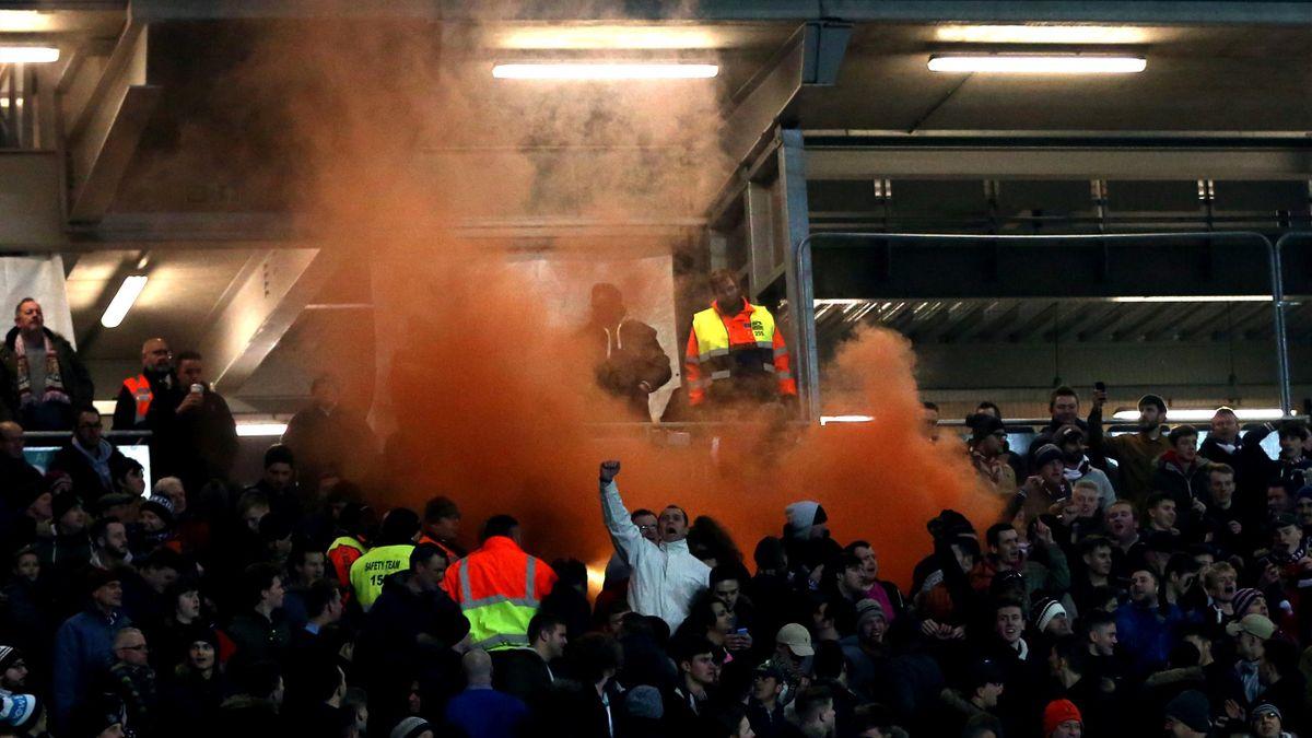 Northampton fans set off a flare