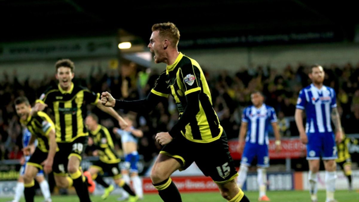 Tom Naylor, centre, rescued a point for Burton