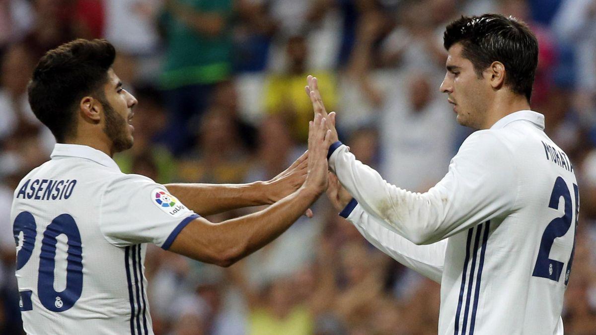 Morata y Asensio celebran un gol ante el Stade Reims