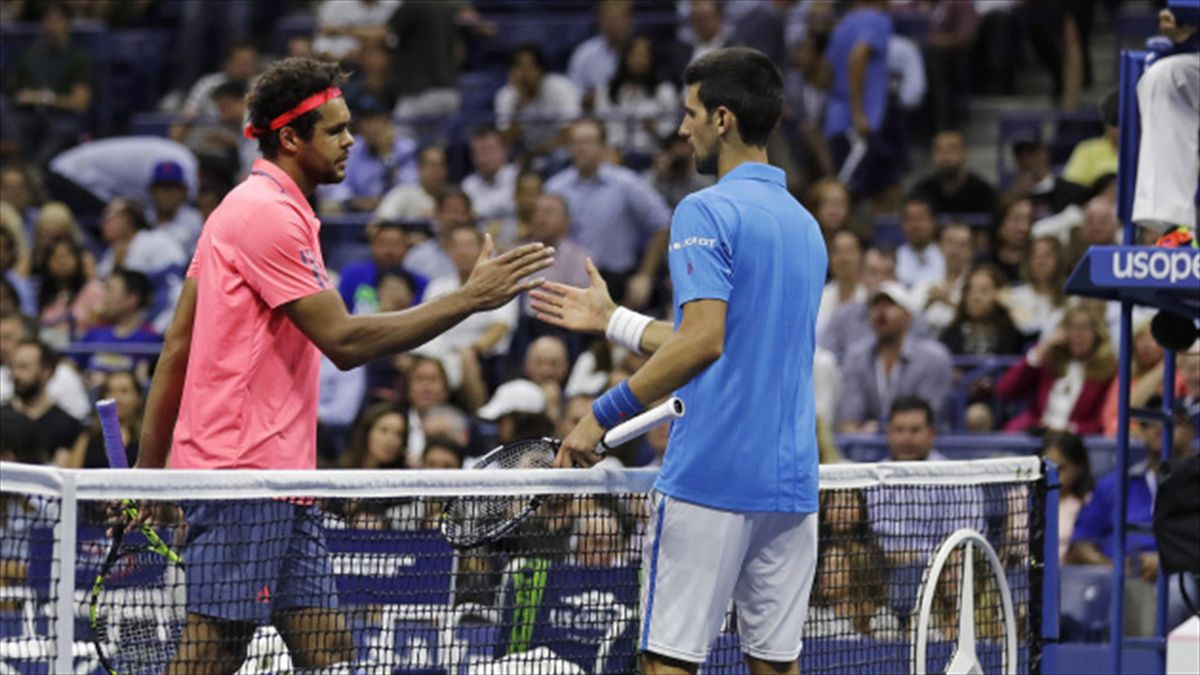 Novak Djokovic, right, advanced to the semi-finals after Jo-Wilfried Tsonga was forced to retire (AP)