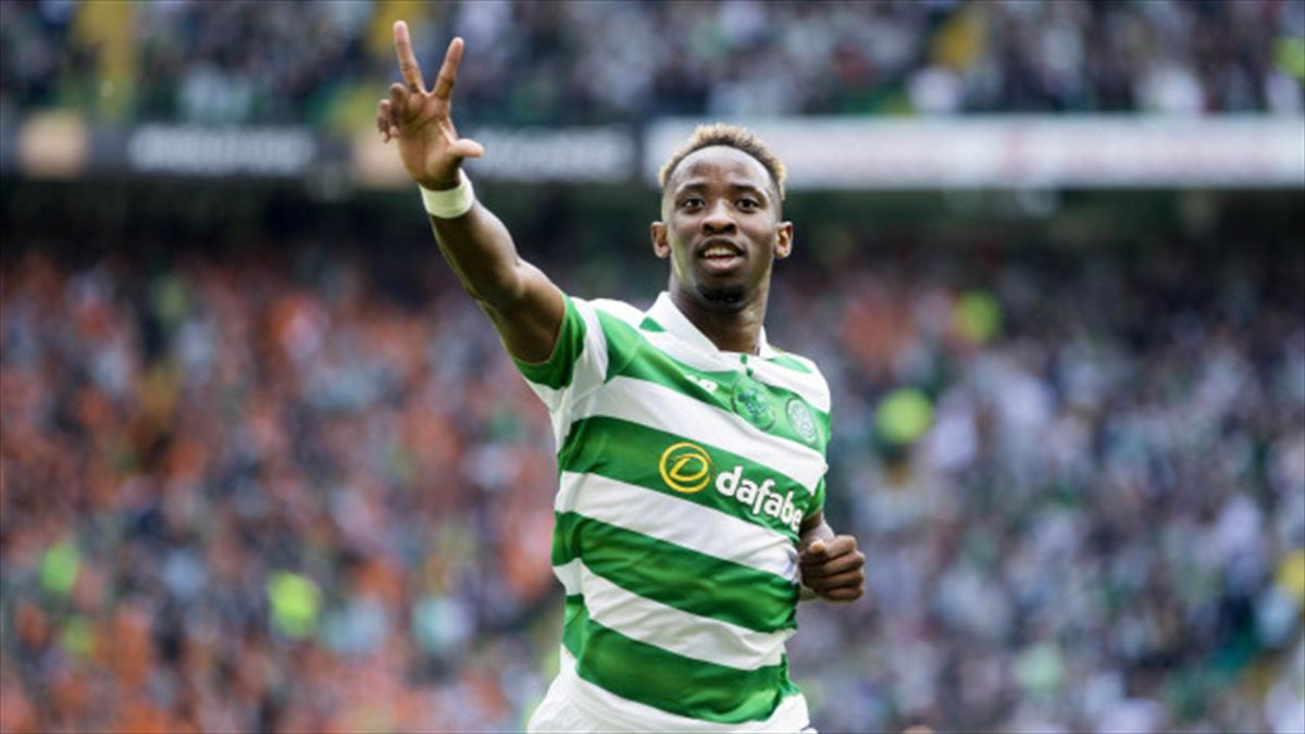 Moussa Dembele celebrates his hat-trick as Celtic comfortably saw off Rangers