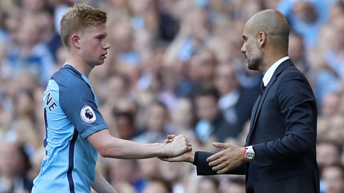Kevin De Bruyne, left, is congratulated by his manager Pep Guardiola