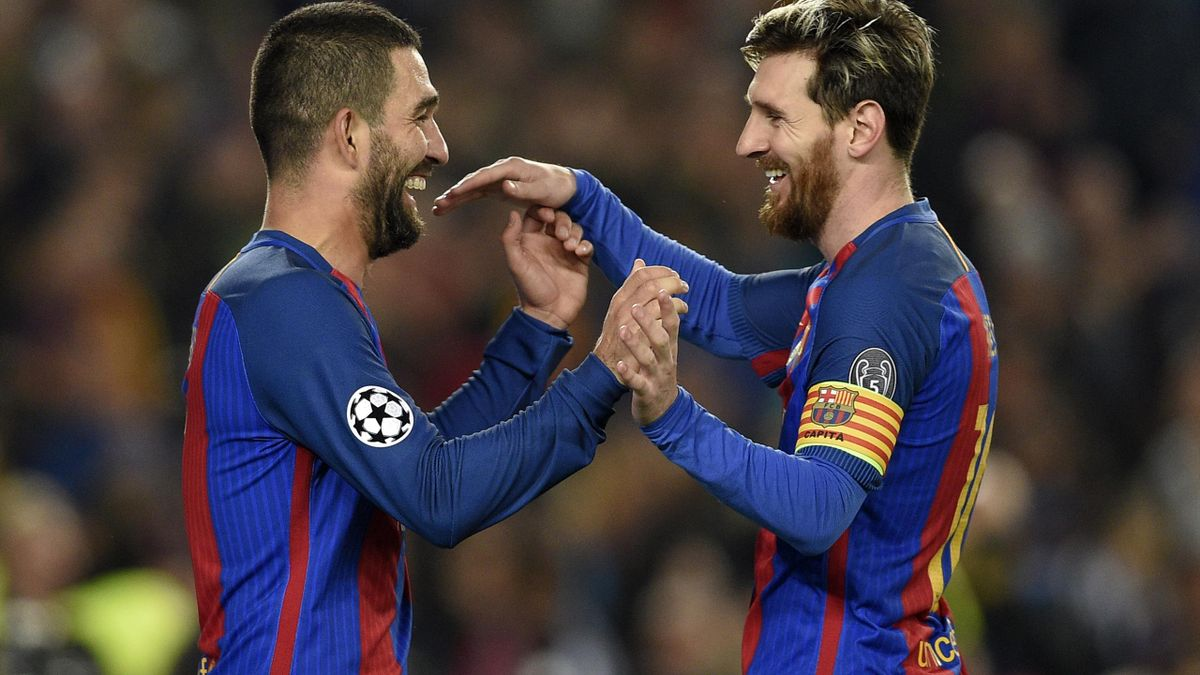 Barcelona's Turkish forward Arda Turan (L) celebrates with Barcelona's Argentinian forward Lionel Messi after scoring during the UEFA Champions League Group C football match FC Barcelona vs Borussia Moenchengladbach at the Camp Nou stadium in Barcelona,
