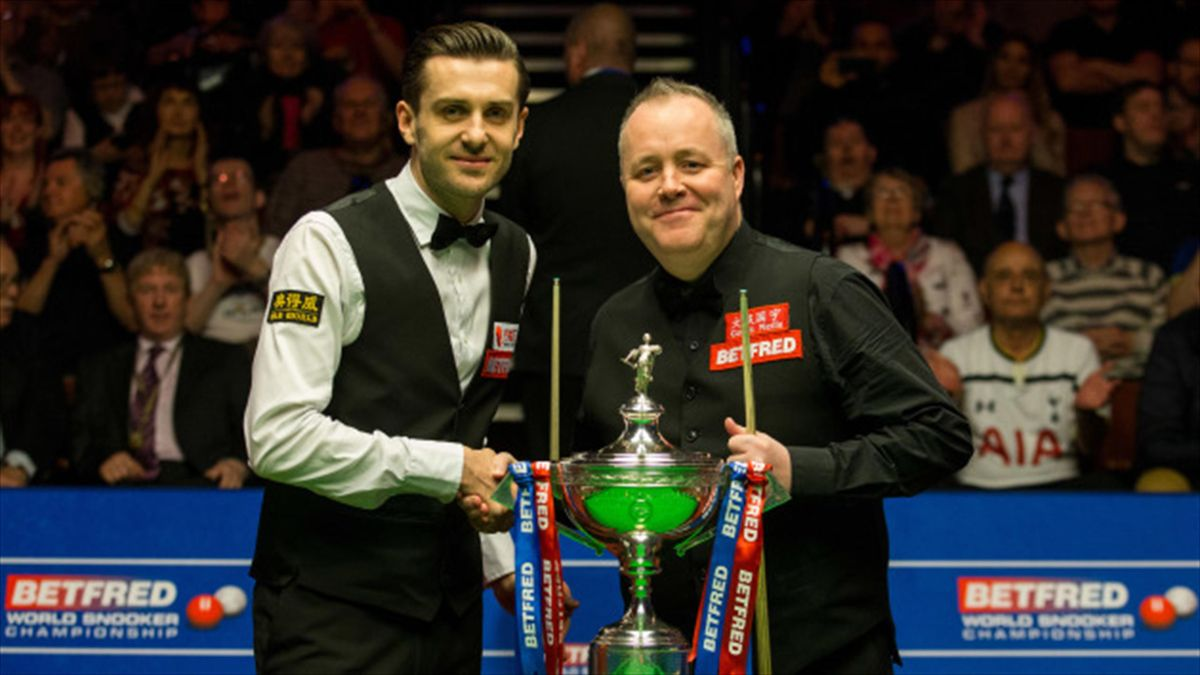 Mark Selby and John Higgins shake hands at the start of the World Championship final