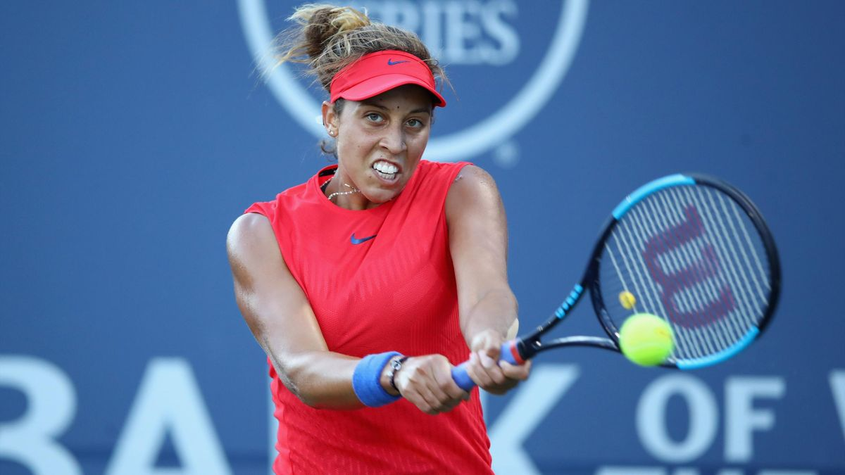 Madison Keys of the United States returns a shot to Garbine Muguruza of Spain during their semifinal match on Day 6 of the Bank of the West Classic at Stanford University Taube Family Tennis Stadium on August 5, 2017 in Stanford, California.