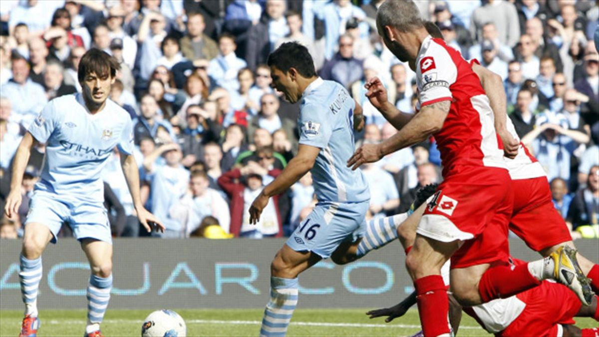 Sergio Aguero, centre, scored Manchester City's winning goal against QPR