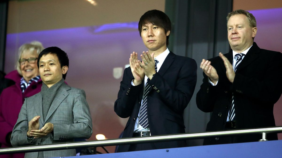 West Brom chief executive Mark Jenkins with owner Guochuan Lai (far left). (Nick Potts/PA)