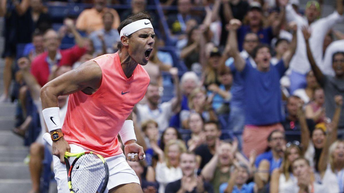 Rafael Nadal celebrates winning the second set against Karen Khachanov