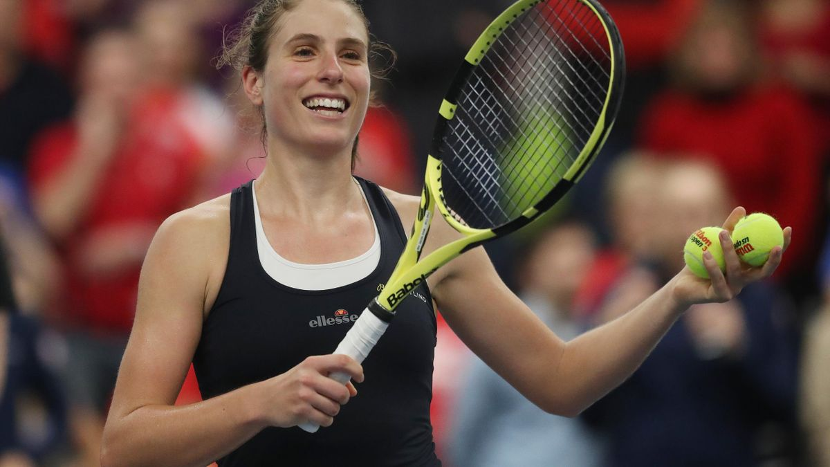 Johanna Konta helped Great Britain secure a Fed Cup point against Slovenia in Bath