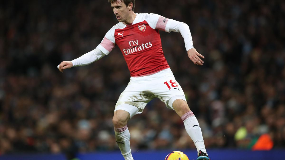 Nacho Monreal expects a tough fight for Champions League qualification