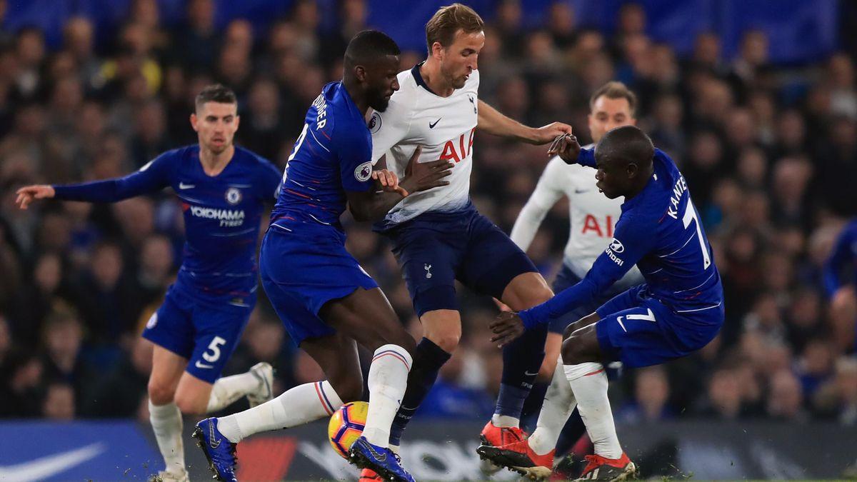 Tottenham captain Harry Kane takes on Chelsea's Antonio Rudiger, left, and N'Golo Kante