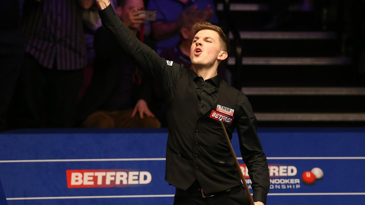 James Cahill celebrates after beating Ronnie O'Sullivan 10-8