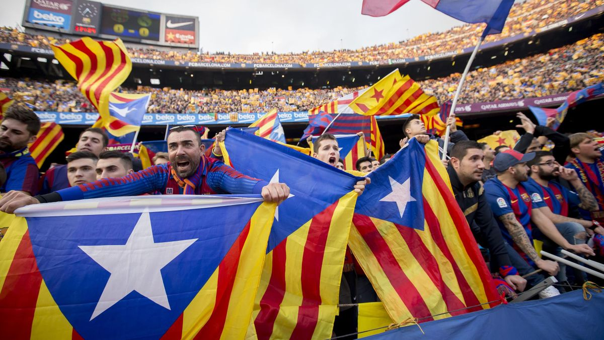 Barcelona's supporters hold proindepence flags during the spanish football league match between FC Barcelona and Real Madrid in Barcelona, on December 3, 2016.
